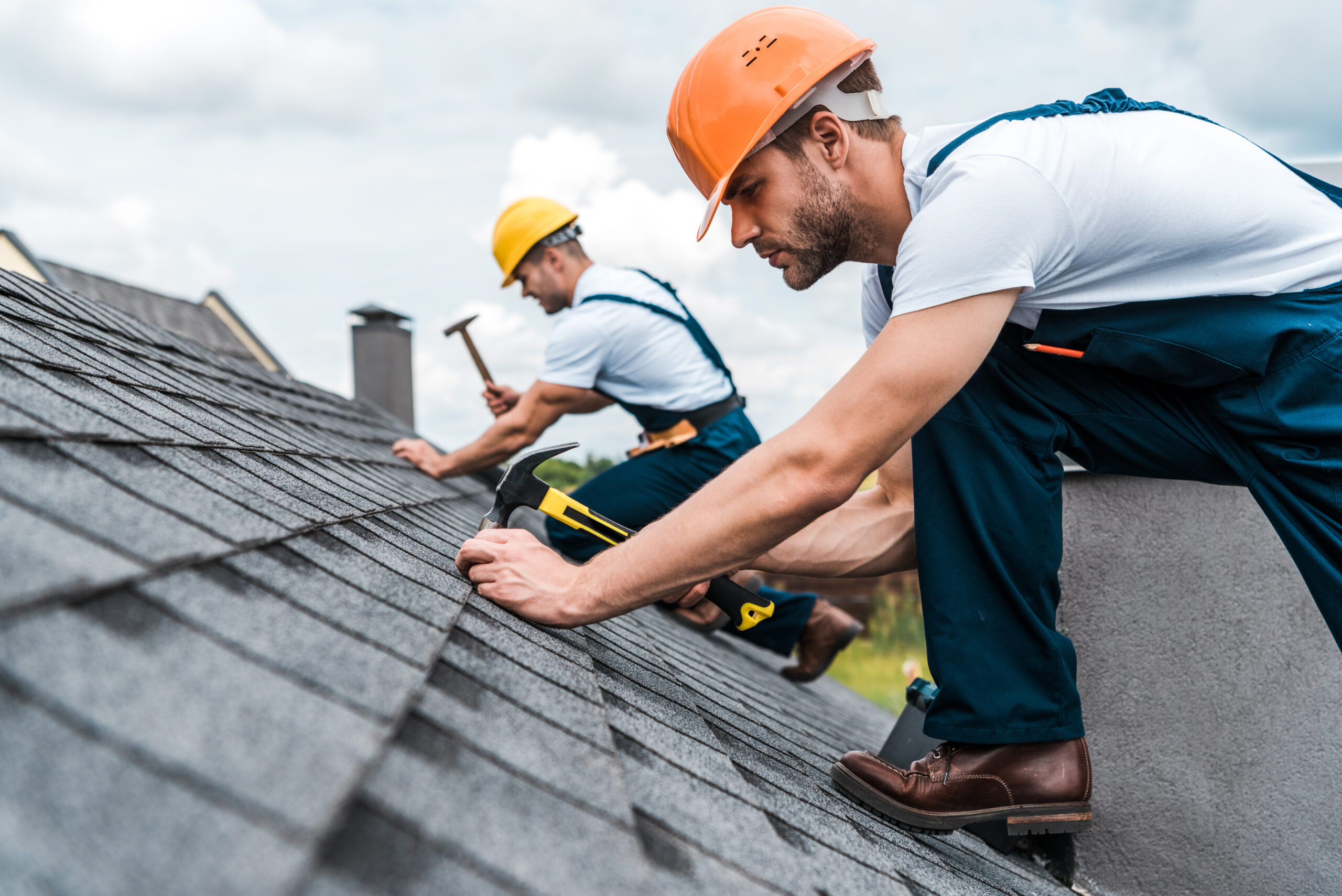Roofer repairing roof in Vancouver
