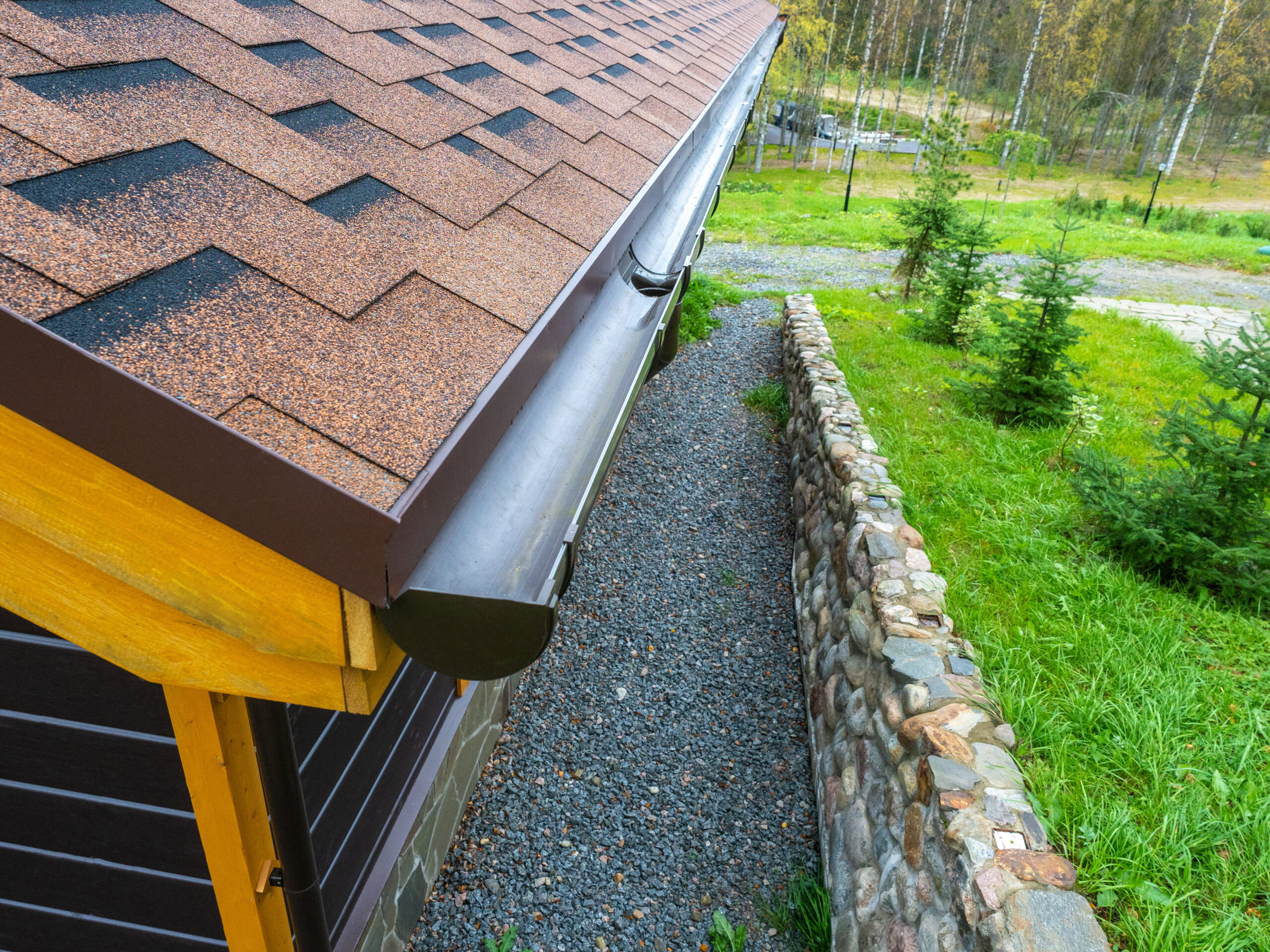 Holder gutter drainage system on the roof. Drain on the roof of the house. Roof drainage. Water drainage from the roof.